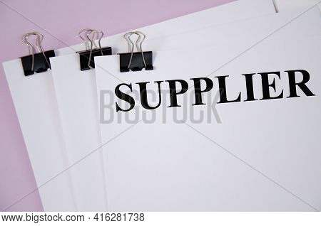 Suppliers The Text Is Written On A White Piece Of Paper And A Pink Background. Word