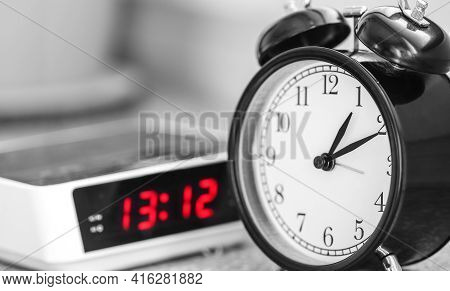 Twin Bell Classic Alarm Clock With Modern Electronic Alarm Clock With Radio In Background