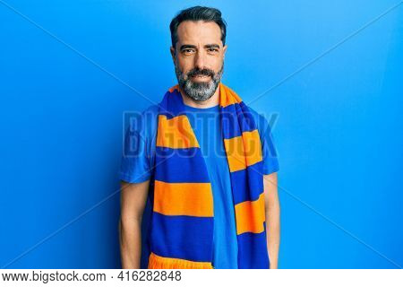 Middle age man with beard and grey hair football hooligan cheering game with a happy and cool smile on face. lucky person.