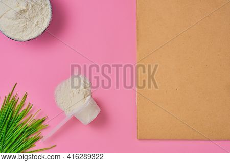 Collagen Powder In Measuring Cup On Red Background , Top View With Copy Space. Notepad For Keeping T