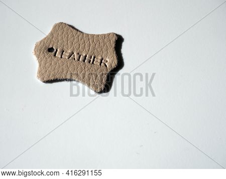 Leather Tags Or Label On White Background. Top View. The Inscription Leather Is Embossed On The Surf
