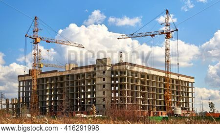 Construction Of A Multi-storey Building In A Vacant Lot. Construction Cranes Against The Sky. Housin