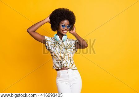 Photo Of Pretty Nice Lady Stand Touch Hairdo Wear Headphones Spectacles T-shirt Trousers Isolated On