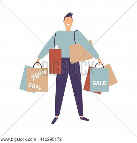 Smiling Shopaholic Man Hold A Lot Of Shopping Bags. Happy Male Enjoy Discounts. Guy Stand With Packa