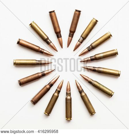 A Group Of Bullet Ammunition Shells In A Circle On A White Background