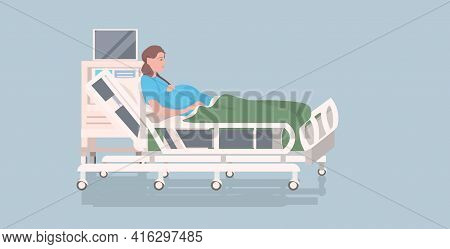 Pregnant Woman Lying In Hospital Bed Before Childbirth Maternity Pregnancy Concept Full Length