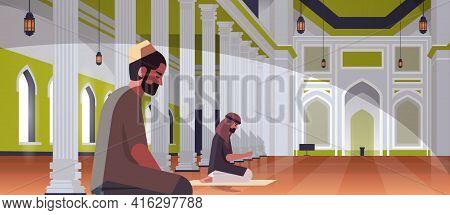 Religious Muslim Men Couple Kneeling And Praying Inside Nabawi Mosque Building Ramadan Kareem Holy M