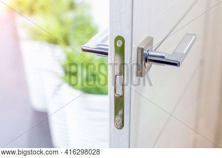 White Open Interior Door With Chrome Handle. Contemporary Door Handle. Selected Focus