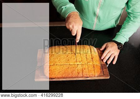 Copy Space For Recipe For Cooking And Caucasian Man Cutting A Sweet Cake Into Portions. And Caucasia