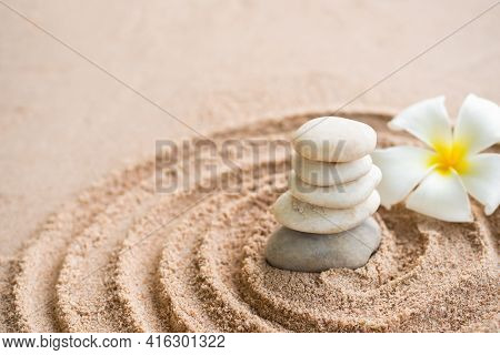 Japanese Zen Garden Stone On Sand Beach. Rock Or Pebbles With Plumeria Flowers With Copy Space. For