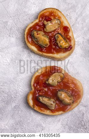 Open Sandwich With Mussels In Tomato Sauce. Homemade Sandwich With Toaster On A Light Background, To