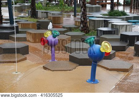 Yeppoon, Queensland, Australia - April 2021: Colorful Round Water Spouts In A Public Childrens Playg
