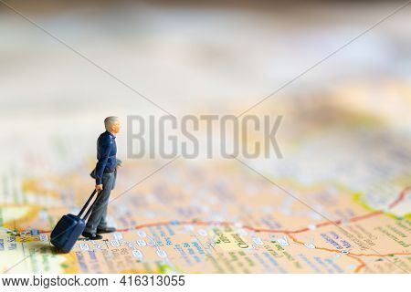 Miniature Business People Standing On Map