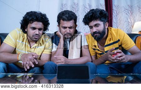 Three Indian Young Cricket Fans Holding Bat And Ball Watching Interesting Live Streaming Cricket Mat