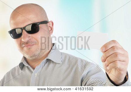 Businessman Holding A Blank Business Card.