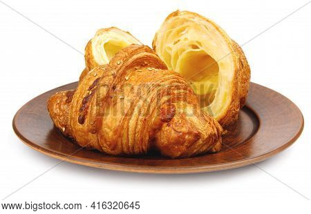Croissant And Cut Croissant On A Clay Plate. Croissant Isolated On White Background. Side View .