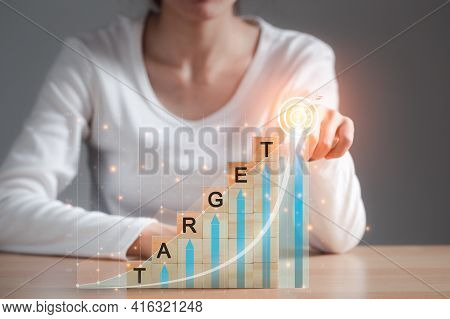 Business Woman Try To Arrange Wooden Blocks Into Growing Graphs And Pointing Target Corporate Future