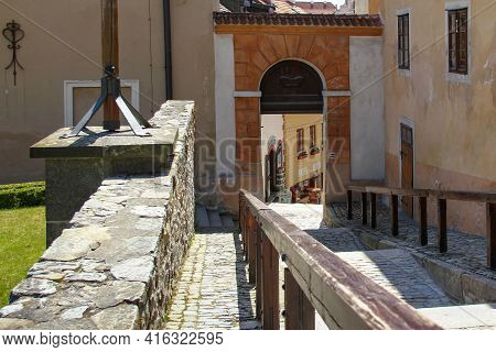 Cesky Krumlov, Czech - April 25, 2012: It Is A Descent From The Castle Down The Street Stairs Throug
