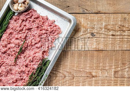 Turkey Or Chicken Mince Raw Meat In A Kitchen Tray. Wooden Background. Top View. Copy Space