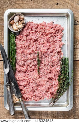 Turkey Or Chicken Mince Raw Meat In A Kitchen Tray. Wooden Background. Top View