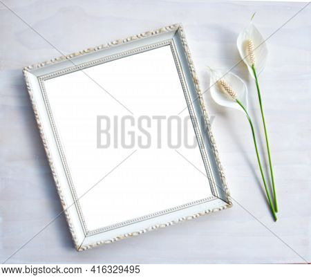 Square Photo Frame With Flower. Photoframe Or Picture Frame Mockup. Clean Feminine Table Flat Layout