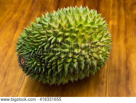 Tropical Fruit Durian On Wooden Background. Whole Tropical Fruit Durian On Wooden Background. Rustic