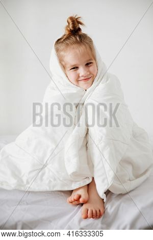 Little Girl Under A Blanket. Early Morning Wake Up To School