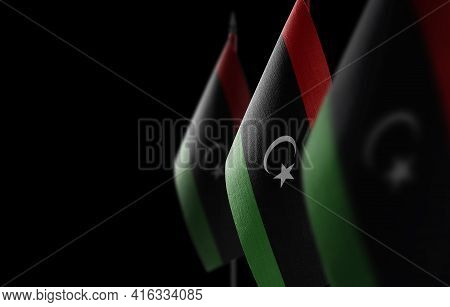 Small National Flags Of The Libya On A Black Background