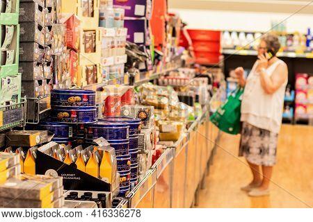 Sydney, Australia 2019-11-22 A Senior Woman Surveying Special Buys Aisle At Aldi Supermarket.