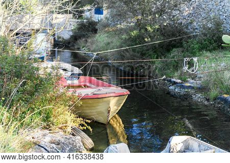 Old Fishing Boats In A Calm Channel Water In Punta Prosciutto, Region Of Puglia, Southern Italy