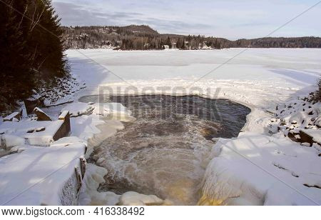 Icy River In The Canadian Winter, Province Of Quebec