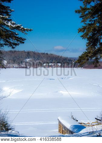 Icy Lake In The Canadian Winter In The Province Of Quebec