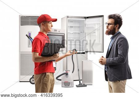 Sales clerk in a home appliances store talking to a bearded man isolated on white background
