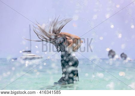 Asian Women Playing In The Sea In Summer.asian Woman With Wet Hair In Sea Water Splash. Fresh Summer