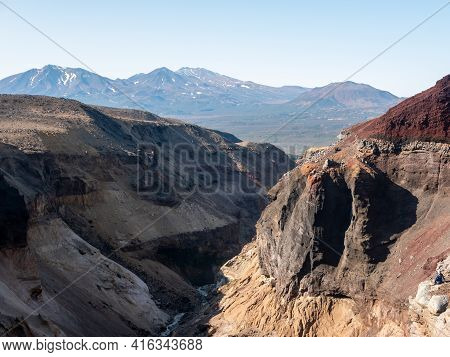 View Of The Opasny Canyon Near The Mutnovsky Volcano. The Depth Of The Canyon Surprises With Its Sca