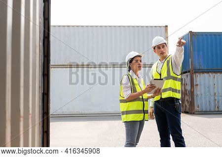 Asian Men And Women Freight  Supervisor Wearing Safety Vest And Hat While Inspect Condition Of All C