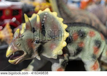 Plastic Dinosaurs (triceratops) At A Flea Market In Hamburg, Germany. Macro Photography Of The Head