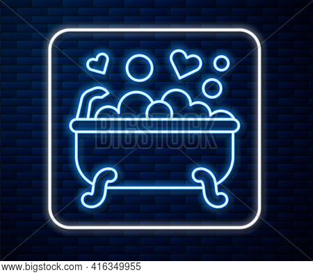 Glowing Neon Line Romantic In Bathroom Icon Isolated On Brick Wall Background. Concept Romantic Date