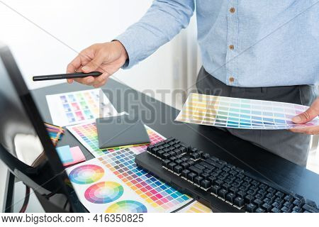 Interior Designer Or Creative Graphic Designer Working On Project Architectural With Colour Samples