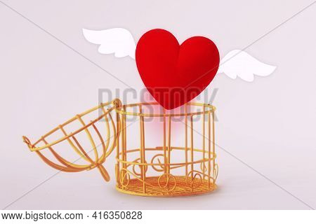 Opened Bird Cage With Escaping Heart - Concept Of Love And Freedom