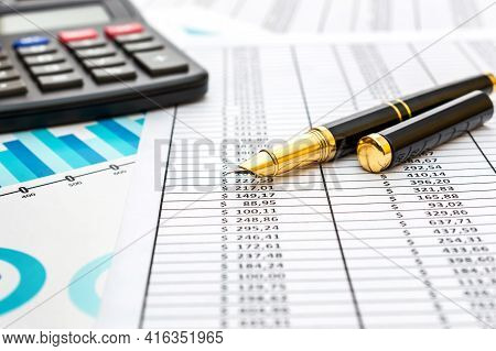Pen With Calculator On Financial Graph And Documents.