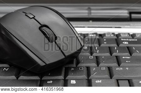 Computer Mouse On  The Laptop Keyboard. Close Up.