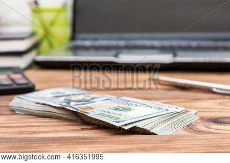 Stack Of Money On The Office Table. Close Up. Business Concept.