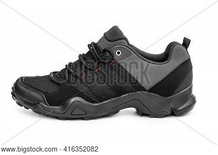 Single Black Sneaker On A White Background.
