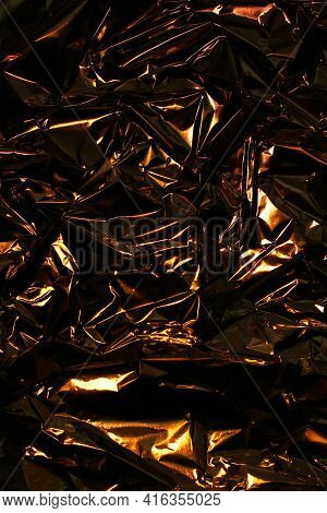 Foil Background. Crumpled Foil. Abstract Background. Wallpaper. Orange And Black