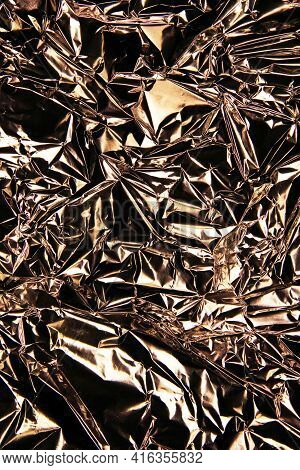 Foil Background. Crumpled Foil. Abstract Background. Wallpaper. Brown. Bronze