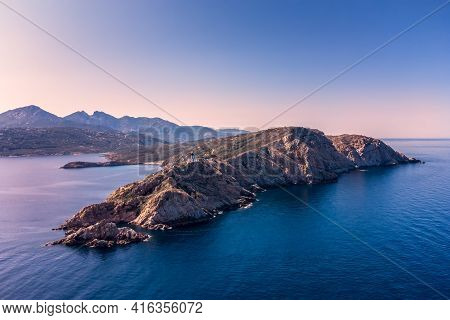 Aerial View Of Revellata Lighthouse In The Evening Sun On A Rocky Promontory Near Calvi In The Balag