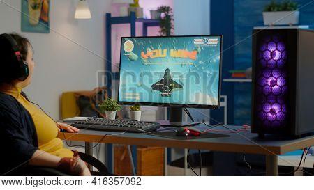 Professional Esports Woman Gamer Wining Playing On Rgb Powerful Computer