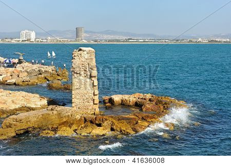 Remains of fortress walls of the Acre and the Mediterranean Sea poster