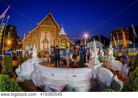 People Pouring Water To Buddha Phra Singh At Phra Singh Temple In Chiang Mai Songkran Festival, Thai